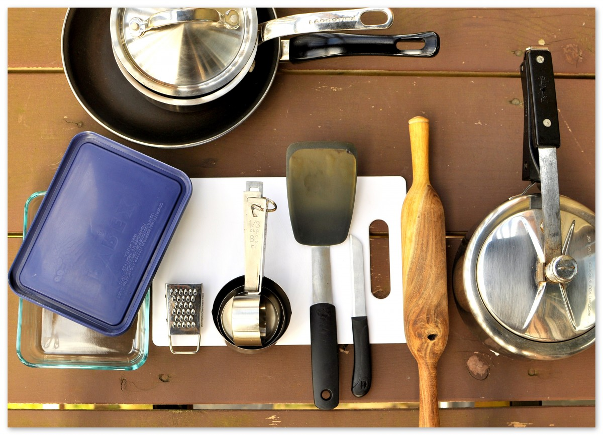 Home-interior-design-featuring-kitchen-items-with-cooking-utensils-on-wooden-table