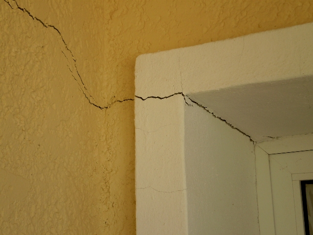 Subsidence cracks in plaster on ceiling